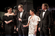 """(R-L) Liv Tyler, Director James Gray, Ruth Negga and Brad Pitt walk the red carpet ahead of the """"Ad Astra"""" screening  during the 76th Venice Film Festival at Sala Grande on August 29, 2019 in Venice, Italy."""
