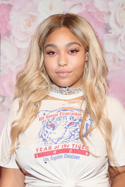 Jordyn Woods went for a fun beauty look with a sweep of pink eyeliner.
