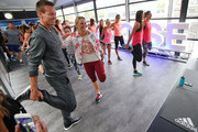 (L-R) Tomas Berdych of the Czech Republic, Caroline Wozniacki of Denmark, Ana Ivanovic of Serbia and Andrea Petkovic of Germany stretch during the adidas ACE Case Launch at Crown Entertainment Complex on January 14, 2016 in Melbourne, Australia.