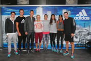 (L-R) Hawthorn AFL player Isaac Smith, Collingwood AFL player Darcy Moore, Tomas Berdych of the Czech Republic, Caroline Wozniacki of Denmark, Andrea Petkovic of Germany and Ana Ivanovic of Serbia, Athlete Morgan Mitchell and Carlton AFL player Bryce Gibbs pose during the adidas ACE Case Launch at Crown Entertainment Complex on January 14, 2016 in Melbourne, Australia.