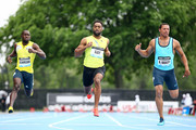 Tyson Gay of the USA wins the 100 Meter Final with Nickel Ashmeade of Jamaica (L) and Ryan Bailey of the USA (R) finishing seventh and second during the Adidas Grand Prix at Icahn Stadium on Randall?s Island on May 25, 2013 in New York City.
