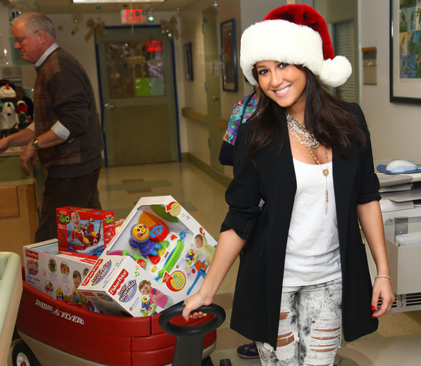 Actress and singer Adrienne Bailon visits children and delivers Fisher Price toys at The Beth Israel Medical Center on December 23, 2009 in New York City.