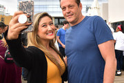 Vince Vaughn takes a photograph with a fan at the Netflix Adult Animation Q&A and Reception on April 20, 2019 in Hollywood, California.