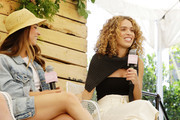 Aly Raisman (L) and Cleo Wade  speak onstage during Aerie REALTreat in Collaboration with Create & Cultivate on June 08, 2019 in Los Angeles, California.