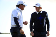 Phil Mickelson of the United States and Keegan Bradley of the United States in discussion on the 13th green during the Afternoon Foursomes of the 2014 Ryder Cup on the PGA Centenary course at the Gleneagles Hotel on September 26, 2014 in Auchterarder, Scotland.