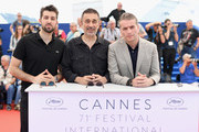 """(L-R) Actor Dogu Demirkol, director Nuri Bilge Ceylan, and Murat Cemcir attend the photocall for the """"Ahlat Agaci"""" during the 71st annual Cannes Film Festival at Palais des Festivals on May 19, 2018 in Cannes, France."""