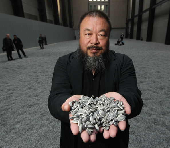 Ai Weiwei Chinese Artist Ai Weiwei holds some seeds from his Unilever Installation 'Sunflower Seeds'  at The Tate Modern on October 11, 2010 in London, England. The sculptural installation comprises 100 million handmade porcelain replica sunflower seeds. Visitors to the Turbine Hall  will be able to walk on the work - which opens on October 12, 2010 and runs until May 2, 2011.