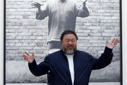Ai Weiwei stands with his sculpture 'Coloured Vases' as he previews works from His landmark art exhibition at the Royal Academy of Arts on September 15, 2015 in London, England. The Royal Academy of Art is showing the work of one of China's leading contemporary artists until mid-December. Ai Weiwei's activism in China saw him detained without charge in 2011 for 81 days.