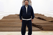 Ai Weiwei stands with his sculpture 'Straight' as he previews works from His landmark art exhibition on September 15, 2015 in London, England. The Royal Academy of Art is showing the work of one of China's leading contemporary artists until mid-December. Ai Weiwei's activism in China saw him detained without charge in 2011 for 81 days.