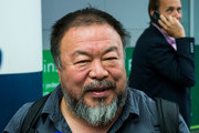 Chinese dissident artist Ai Weiwei speaks to the media upon his arrival at Munich Airport on July 30, 2015 in Munich, Germany. This is his first trip abroad since Chinese authorities put him under house arrest in 2011 and confiscated his passport without charging him with any crime. They recently returned his passport, enabling Ai Weiwei to travel to see his son, who lives in Berlin. His 6-month UK visa application, however, has been rejected because the artist failed to mention any convictions, although he has been granted a 20-day visa to attend the opening of his show in London in September.