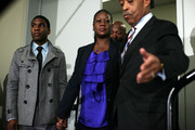 Led by President and Founder of the National Action Network Rev. Al Sharpton (R), family of Trayvon Martin who was fatally shot by neighborhood watch captain George Zimmerman in Florida, mother Sybrina Fulton (2nd L) and brother Jahvaris Fulton (L), and father Tracy Martin (3rd L) arrive at a news conference April 11, 2012 in Washington, DC.  It has been reported that Zimmerman will be charged in the Trayvon Martin shooting according to Florida special prosecutor Angela Corey.