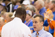 Head coach Billy Donovan of the Florida Gators and head coach Anthony Grant of the Alabama Crimson Tide shake hands after the game at the Stephen C. O'Connell Center on February 08, 2014 in Gainesville, Florida.