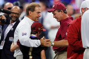 Head coach Nick Saban of the Alabama Crimson Tide speaks with head coach Jimbo Fisher of the Florida State Seminoles prior to their game at Mercedes-Benz Stadium on September 2, 2017 in Atlanta, Georgia.