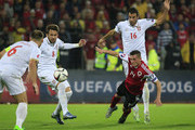 Taulant Xhaka (C) of Albania is challenged by Luka Milivojevic (R) Miralem Sulejmani (L) of Serbia during the UEFA EURO 2016 qualifier between Albania and Serbia at the Elbasan Arena on October 08, 2015 in Elbasan, Albania.