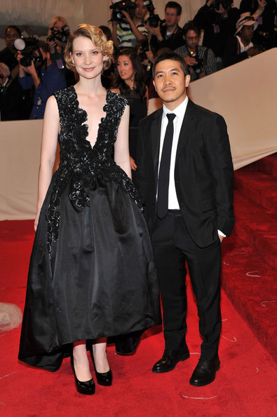 "Actress Mia Wasikowska and designer Thakoon Panichgul attend the ""Alexander McQueen: Savage Beauty"" Costume Institute Gala at The Metropolitan Museum of Art on May 2, 2011 in New York City."