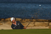 Matt Kuchar of The United States plays out of a greenside bunker on the 12th during day one of the 2018 Alfred Dunhill Links Championship at Kingsbarns on October 4, 2018 in St Andrews, Scotland.