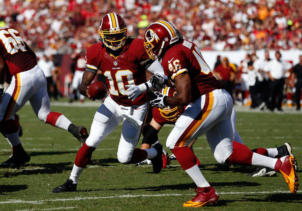 Robert Griffin III hands off to Alfred Morris