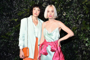 Mia Moretty (L) and Caitlin Moe attend the Alice + Olivia By Stacey Bendet fashion show during February 2020 - New York Fashion Week: The Shows on February 10, 2020 in New York City.