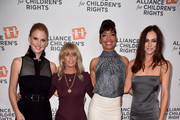 (L-R) Sarah Rafferty, NBCUniversal Cable Chairman Bonnie Hammer, Gina Torres, and Alexandra Park attend The Alliance For Children's Rights 26th Annual Dinner at The Beverly Hilton Hotel on March 28, 2018 in Beverly Hills, California.