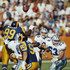 Troy Aikman #8, Quarterback for the Dallas Cowboys throws the ball downfield during the National Football Conference West game against the Los Angeles Rams on 18 November 1990 at the Anaheim Stadium, Anaheim, California, United States. The  Cowboys won the game 24 - 21.
