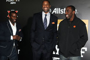 Lamont Evans (L), former basketball player Greg Buckner (C) and football player C.J. Spiller pose on the blue carpet during the  Allstate Party At The Playoff on January 7, 2017 in Tampa, Florida.