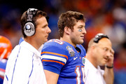 (L-R) Head Coach Urban Meyer Tim Tebow #15 and Offensive coordinator and interim head coach Steve Addazio of the Florida Gators watches from the sidelines during the Allstate Sugar Bowl against the Cincinnati Bearcats at the Louisana Superdome on January 1, 2010 in New Orleans, Louisiana.