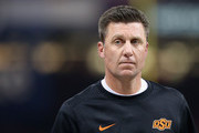 Head coach Mike Gundy of the Oklahoma State Cowboys looks on while playing against the Mississippi Rebels during the second quarter of the Allstate Sugar Bowl at Mercedes-Benz Superdome on January 1, 2016 in New Orleans, Louisiana.