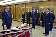 The new Minister of Health, Social Services and Equality, Alfonso Alonso (L), gives the oath of office with (L-R) Vice President of the Spanish government Soraya Saenz de Santa Maria, Prime Minister Mariano Rajoy, King Juan Carlos and Spanish Minister for Justice Rafael Catala at Zarzuela Palace on December 3, 2014 in Madrid, Spain.