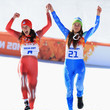 Swiss Dominique Gisin and Slovenian Tina Maze won joint gold medals during the too-close-to-call Women's Downhill Alpine Skiing.