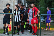 Simon Everett (2L) captain of Alresford Town and Chris Mason (R) the captain of Winchester City wait to lead out their teams during the FA Cup Extra Preliminary Round match between Alresford Town and Winchester City at Alrebury Park on August 16, 2013 in New Alresford, England.