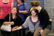 Amanda Knox (C), is comforted by sister Deanna Knox (R), and mother Edda Mellas (L) during a press conference on October 4, 2011 in Seattle, Washington. American student Amanda Knox arrived back in hometown of Seattle, WA from Rome, Italy after she and ex-boyfriend Raffaele Sollecito won the appeal against the conviction in 2009 of killing their British roommate Meredith Kercher in Perugia, Italy in 2007. The pair had served nearly four years in jail after initially being sentenced to 26 and 25 years respectively.