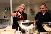 (L-R) Guy Fieri and Marc Whitten, Vice President, Amazon Fire TV prepare a recipe onstage at the Amazon After Hours event during CES 2020 at The Venetian Las Vegas on January 07, 2020 in Las Vegas, Nevada.