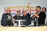 """(L-R) Founder & CEO of Goldbelly, Joe Ariel, Nick Gordon, Manny Loizos, Adam Richman and Frank Luciano celebrate the winning sandwich """"The Bomb"""" by Sal, Kris and Charlie's Deli at America's Greatest Sandwich Showdown during New York City Wine & Food Festival at Highline Stages on October 13, 2019 in New York City."""