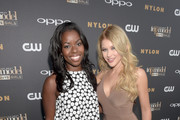 """Actresses Camille Winbush (L) and Renee Olstead attend the """"America's Next Top Model"""" Cycle 22 Premiere Party presented by OPPO and NYLON on July 28, 2015 in West Hollywood, California."""