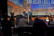 Musician Paul Shaffer presents and award to Harry Shearer during the American Eagle Awards Honoring Crystal Gayle, Patti Smith and Harry Shearer at Music City Center on July 13, 2017 in Nashville, Tennessee.