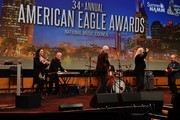 Musicians Crystal Gayle, Paul Shaffer, Richard Leigh, Patti Smith and Harry Shearer performs during the American Eagle Awards Honoring Crystal Gayle, Patti Smith and Harry Shearer at Music City Center on July 13, 2017 in Nashville, Tennessee.