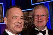 Actor Tom Hanks (L) and AFI Board of Trustees Chair Howard Stringer pose in the audience during American Film Institute's 44th Life Achievement Award Gala Tribute to John Williams at Dolby Theatre on June 9, 2016 in Hollywood, California. 26148_005