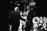 Image has been converted to black and white.) Writer George Stevens Jr. (L) and actor Sidney Poitier react onstage during American Film Institute's 45th Life Achievement Award Gala Tribute to Diane Keaton at Dolby Theatre on June 8, 2017 in Hollywood, California. 26658_001