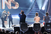 """Host Ryan Seacrest (R) announces Caleb Johnson as the winner with American Idol Finalist Jena Irene and American Idol Judges Harry Connick, Jr., Jennifer Lopez, and Keith Urban onstage during Fox's """"American Idol"""" XIII Finale at Nokia Theatre L.A. Live on May 21, 2014 in Los Angeles, California."""
