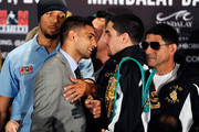 (L-R) Amir Khan's  strength and conditioning coach Ruben Tabares places his arm between boxers Amir Khan and Danny Garcia as Garcia's father and trainer Angel Garcia looks on during the final news conference at the Mandalay Bay Resort & Casino on July 12, 2012 in Las Vegas, Nevada. The two fighters will battle for the WBC super lightweight world championship on July 14 in Las Vegas.