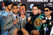 (L-R) Strength and conditioning coach Ruben Tabares, boxer Amir Khan, President of Golden Boy Promotions Oscar De La Hoya, boxer Danny Garcia and trainer Angel Garcia pose during the final news conference at the Mandalay Bay Resort & Casino on July 12, 2012 in Las Vegas, Nevada. The two fighters will battle for the WBC super lightweight world championship on July 14 in Las Vegas.