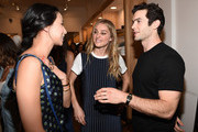 (L-R) Lily Kwong, Elizabeth Gilpin and Ethan Peck attend the Amour Vert x Swith Boutique celebration at Switch Boutique on March 26, 2015 in Beverly Hills, California.