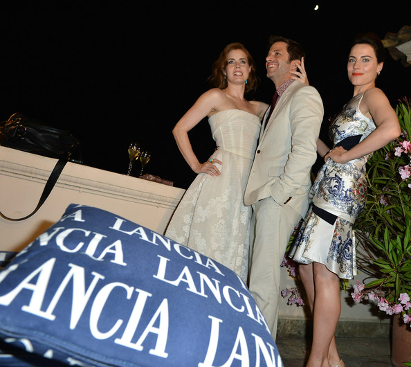Celebrities At The Lancia Cafe - Day 1 - Taormina Filmfest 2013 [dress,gown,luxury vehicle,lady,beauty,fashion,shoulder,event,formal wear,fun,taormina filmfest,lancia cafe,taormina,italy,celebrities,zack snyder,antje traue,amy adams]