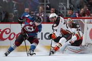 Carl Soderberg #34 of the Colorado Avalanche controls the puck against Simon Despres #24 of the Anaheim Ducks as goalie John Gibson #36 of the Anaheim Ducks defends the goal at Pepsi Center on April 9, 2016 in Denver, Colorado.