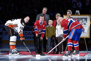 Former Montreal Canadien player Saku Koivu takes the ceremonial face-off with former teammates Ryan Getzlaf #15 of the Anaheim Ducks and Andrei Markov #79 of the Montreal Canadiens during a ceremony honouring the former team captain prior to the NHL game between the Montreal Canadiens and the Anaheim Ducks  at the Bell Centre on December 18, 2014 in Montreal, Quebec, Canada.