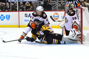 Hampus Lindholm #47 of the Anaheim Ducks holds down Patric Hornqvist #72  of the Pittsburgh Penguins at PPG PAINTS Arena on December 23, 2017 in Pittsburgh, Pennsylvania.