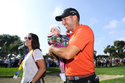 Sergio Garcia of Spain celebrates with his wife Angela Akins Garcia and their daughter after he wins the tournament as the third round resumes play on day five of Andalucia Valderrama Masters at Real Club Valderrama on October 22, 2018 in Cadiz, Spain. The event has been shorted to a 54 hole tournament due to bad weather.