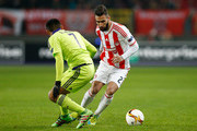 Jimmy Durmaz of Olympiacos and Andy Najar of Anderlecht compete for the ball during the UEFA Europa League round of 32 first leg match between Anderlecht and Olympiakos FC at Constant Vanden Stock Stadium on February 18, 2016 in Brussels, Belgium.