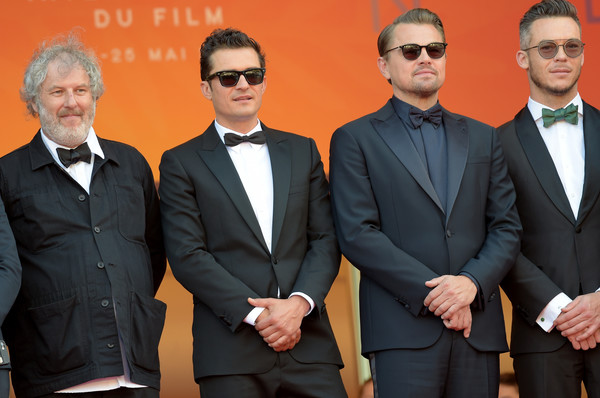 'The Traitor' Red Carpet - The 72nd Annual Cannes Film Festival [the traitor red carpet,suit,formal wear,white-collar worker,event,tuxedo,businessperson,management,team,andre lotterer,orlando bloom,leonardo dicaprio,malcolm venville,l-r,cannes,france,the 72nd annual cannes film festival,screening]