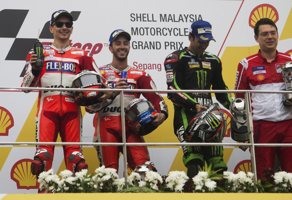 MotoGP of Malaysia - Race [technology,electronic device,championship,podium,team,competition event,motorcycle racer,stage equipment,vehicle,jorge lorenzo,johann zarco,l-r,podium,malaysia,spain,ducati team,motogp of malaysia - race,race,end]